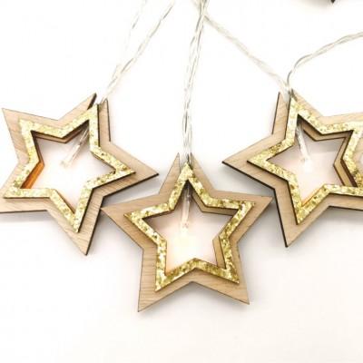 Σειρά με ξύλινα αστέρια και χρυσαφί glitter σε διάφανο καλώδιο 135cm